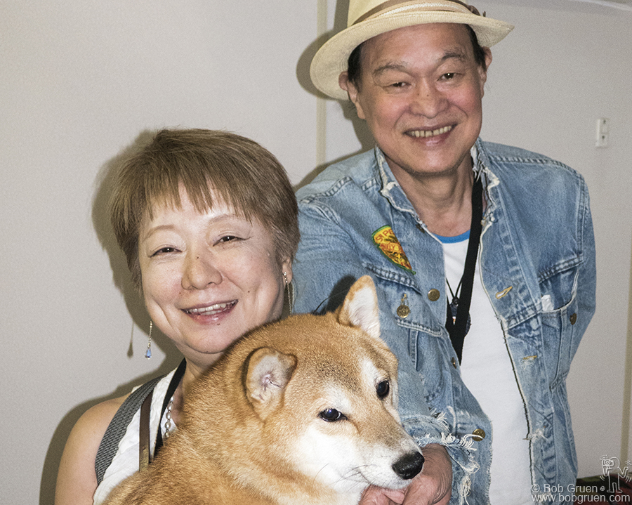 July 26 – Naeba, Japan- Fuji Rock Festival founder and producer Masa Hidaka and Shigemi with Nana, their cute Shiba Inu dog, welcomed us to the 21st festival. Although they are the top people producing a festival of over 15o,ooo people with hundreds of acts and artists spread out over two miles along the bottom of a mountain in the north west of Japan they are amazingly gracious hosts to all the fans who come.