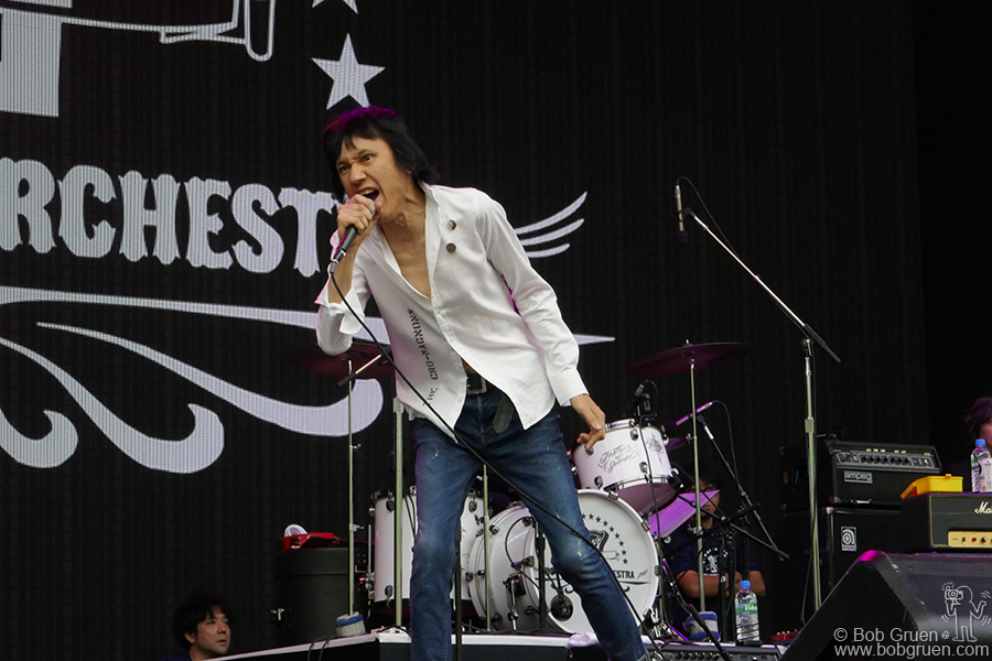 July 27 – Naeba, Japan – Hiroto Komoto performing with the Route 17 Rock and Roll Orchestra on stage during Fuji Rock Festival. He's known as the 'Iggy Pop of Japan' and he was as wild as always.