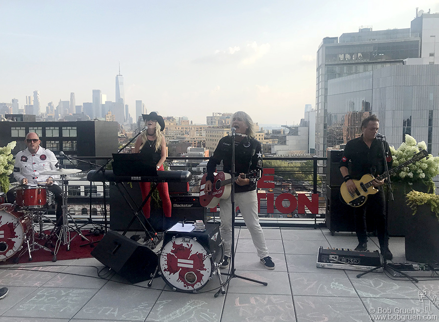 Aug 6 – NYC – The Alarm performing on the Live Nation office roof to announce a reunion tour.