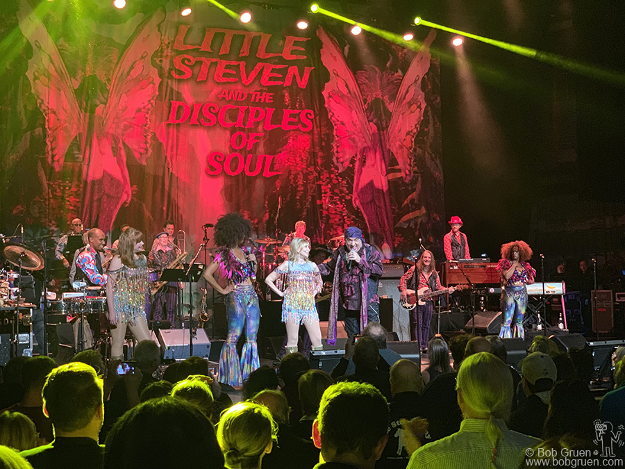 Nov 6 - NYC - When he's not acting in  TV series or DJing on Sirius Radio Little Steven tours with his band the Disciples of Soul, seen here with his wife Maureen on stage at the Beacon Theatre.